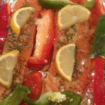 healthy food for dieting and weight loss with salmon, peppers and lemons